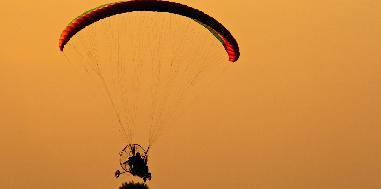 Enjoy the thrilling experience of tandem paramotoring in the outskirts of Delhi for one