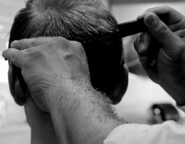 Traditional haircut for him with a calming head massage